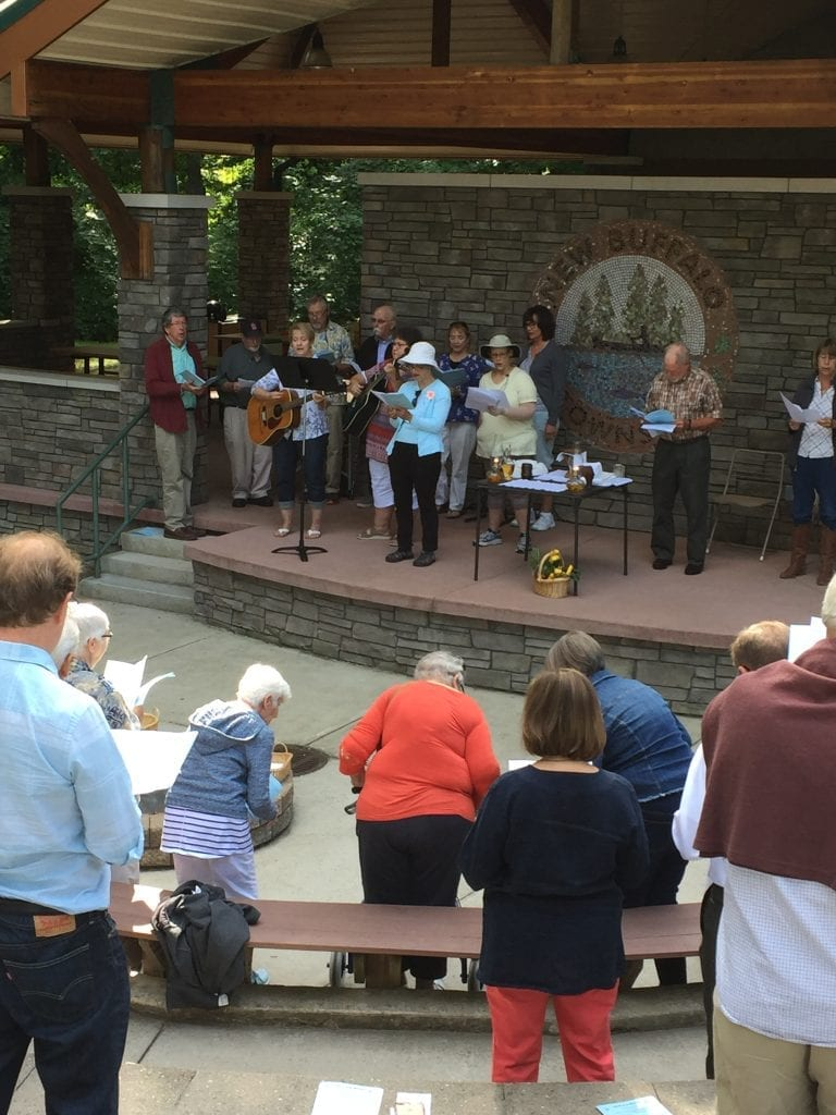 Choir leading the parish in singing